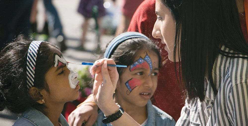 Face painting at the Downtown Farmers' Market